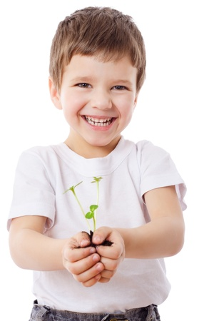 Smiling boy with sprouts in hands, isolated on white Stockfoto