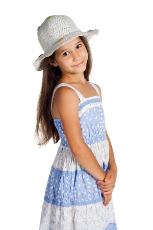 touched: Portrait of cute little girl in blue dress and hat, isolated on white