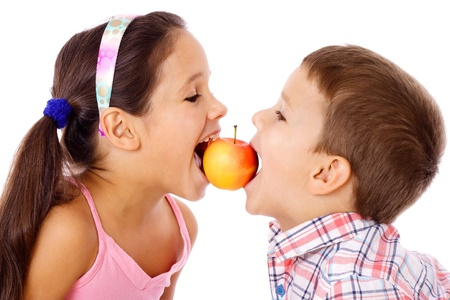 nip: Two kids sharing the apple, isolated on white