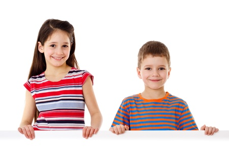 Two smiling kids standing with empty horizontal blank in hands, isolated on white photo