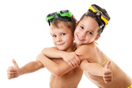 swim mask: Two happy kids in diving masks standing together, isolated on white
