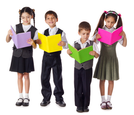 Four smiling schoolchild standing with colorful books, isolated on white photo