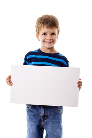 child holding sign: Smiling boy standing with empty horizontal blank in hands, isolated on white