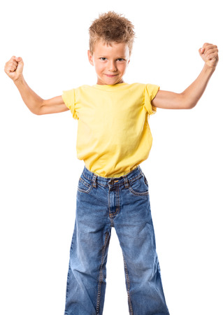 Portrait of a strong kid showing the muscles of his arms, isolated on white photo