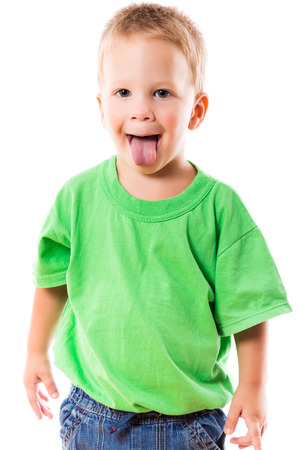 Little boy with funny face and sticked out tongue, isolated on white