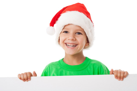 Christmas boy standing with empty horizontal banner in hands, isolated on white photo