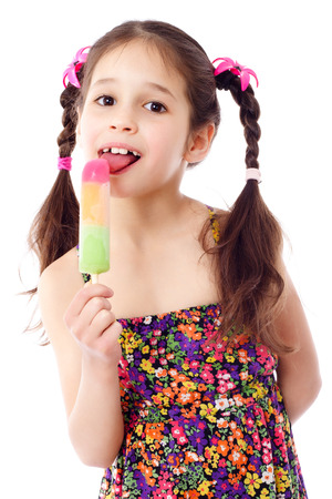 Girl licking the water ice cream, isolated on white photo