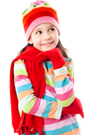 Smiling girl in winter clothes looking sideways, isolated on white