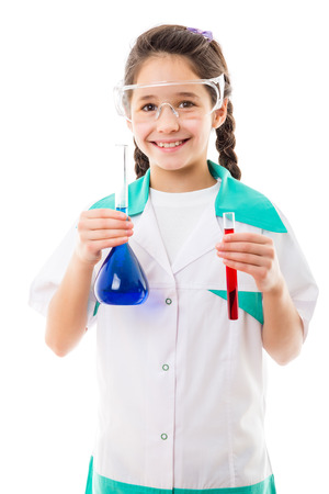 Smiling girl in protective wear holding a chemical flask and test tube, isolated on white photo
