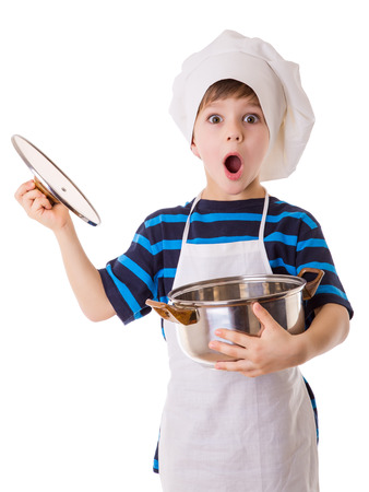 Amazing little chef opens the pot, isolated on white Stockfoto