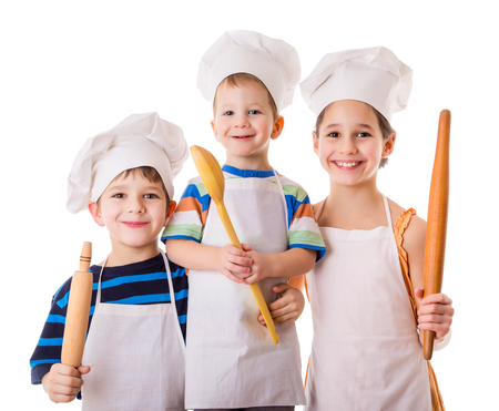 Three young chefs with ladle and rolling pin, isolated on white photo