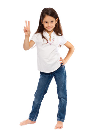 young girl barefoot: Young girl showing victory gesture, isolated on white