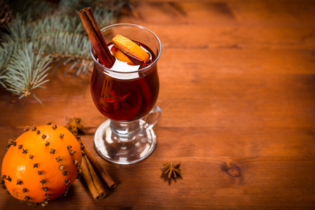 christmas tea: wooden with mulled wine, spice and orange, space for text Stock Photo