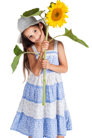 Smiling girl in hat with sunflower, isolated on white photo