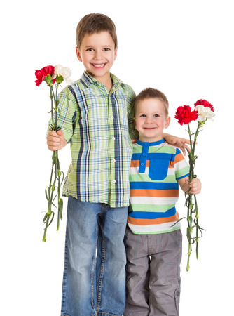 Two kids with carnations for greetings, isolated on white photo