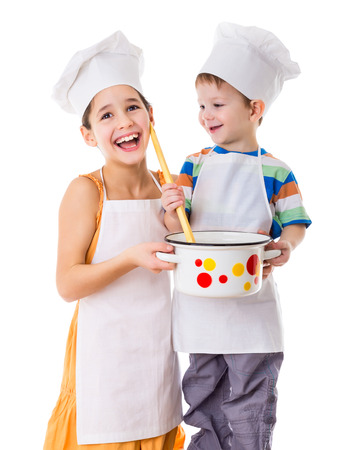 elementary age boys: Two smiling kids with pan and big ladle, isolated on white Stock Photo