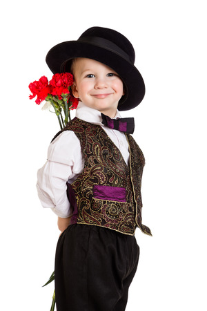 Smiling boy in hat hiding behind a bouquet of carnations, isolated on white photo