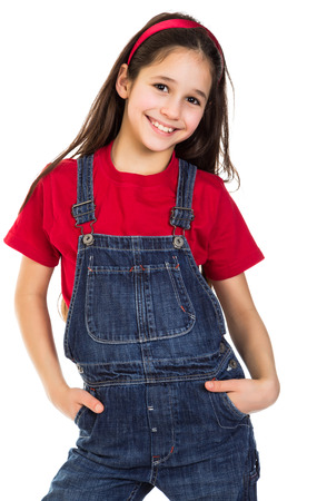 Smiling girl in coveralls, isolated on white; photo