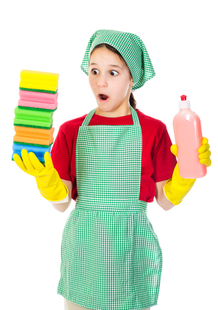 Surprised girl with colorful sponges isolated on white photo