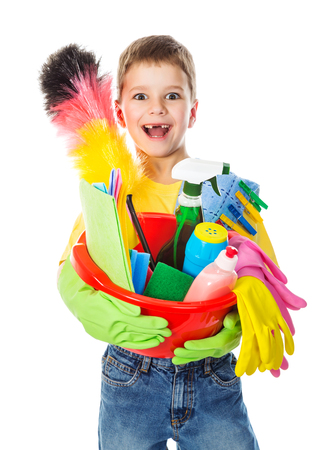 domestic chore: Happy boy with cleaning tools, isolated on white Stock Photo
