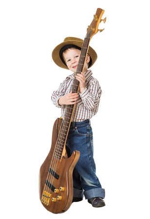 Little boy in hat standing with rock guitar, isolated on white photo