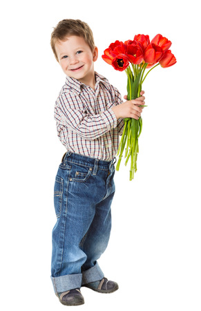 Happy boy with bouquet of a red tulips, isolated on white Stock Photo