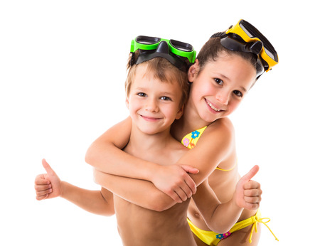 family beach: Two happy kids in diving masks standing together, isolated on white