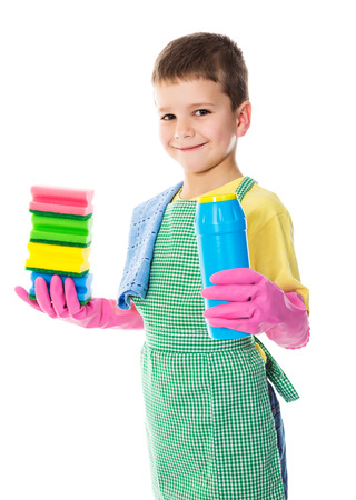 Smiling boy with colorful sponges and scouring powder, isolated on white photo