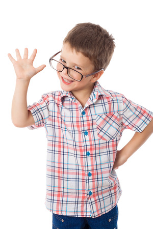 Happy little boy in glasses with greeting sign, isolated on white Stockfoto