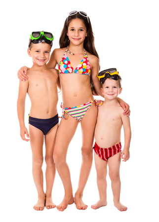 Three happy kids in diving masks standing together, isolated on white photo
