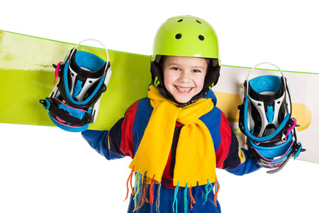 Happy boy standing with snowboard, isolated on white Stockfoto