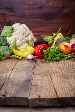 carrot: Plenty of colorful vegetables on wooden table Stock Photo