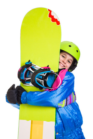 studio happy overall: Smiling girl with green snowboard, isolated on white