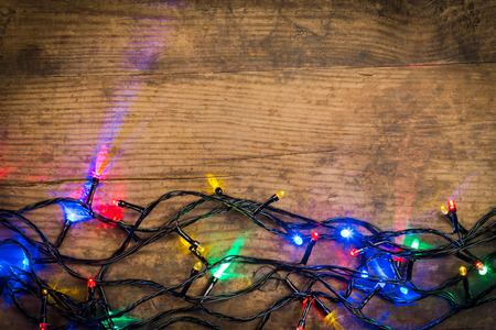 festoon: LED Christmas lights on wooden background, abstract template Stock Photo
