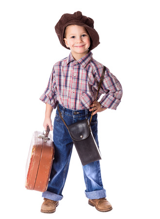 old suitcase: Little boy standing with old suitcase, isolated on white