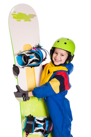studio happy overall: Happy boy standing with snowboard, isolated on white Stock Photo
