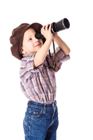 far away look: Little boy looking to spyglass, isolated on white Stock Photo