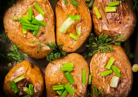 oven tray: baked potatoes with green onion in oven tray