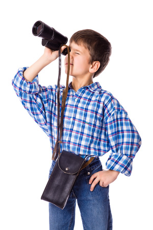 far away look: boy looking to spyglass, isolated on white