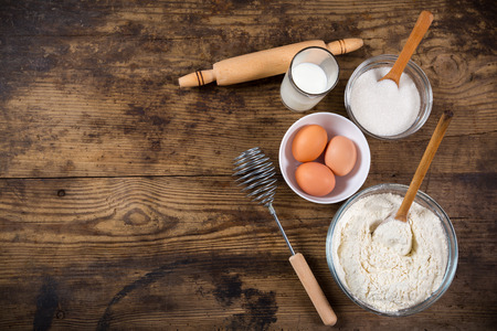 egg white: baking ingredients on dark wooden table with empty space