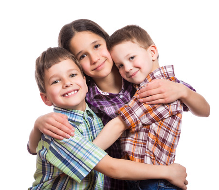 Family with three happy kids hugging together, isolated on white