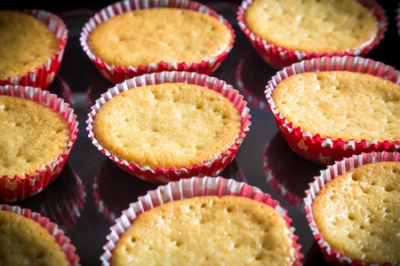 bisquit: Fresh sweet baked cupcakes on the tray Stock Photo