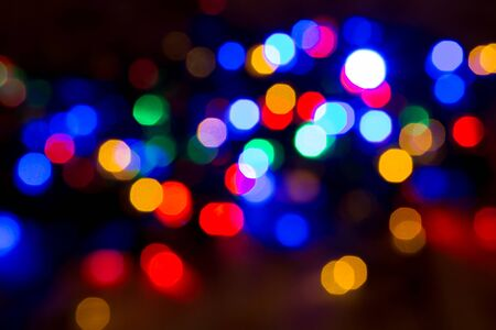 christmas lights background: blurred christmas lights abstract background on black Stock Photo