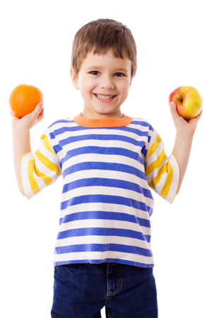 studio  isolated: Happy boy holds a orange and apple, isolated on white