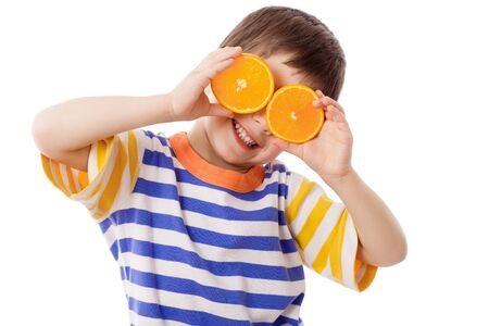 round face: Funny boy with fruits on eyes, isolated on white