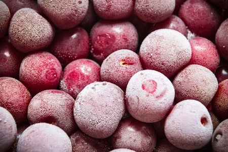 cold storage: closeup frozen berries of cherry, food background
