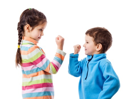 threaten: Two children threaten each other a fist, mutual relations concept, isolated on white Stock Photo