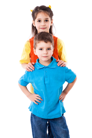 cute girl smiling: Two smiling children standing together, isolated on white