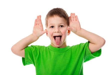 prankster: Funny little boy teasing with hands and tongue, isolated on white
