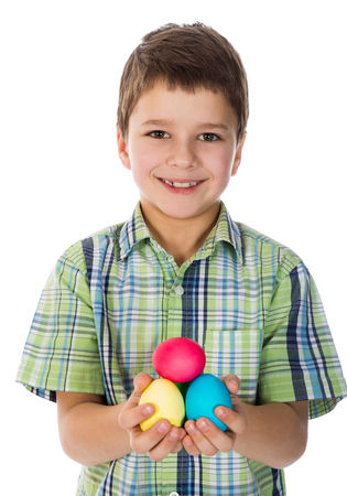 kids painted hands: boy showing painted easter eggs, isolated on white